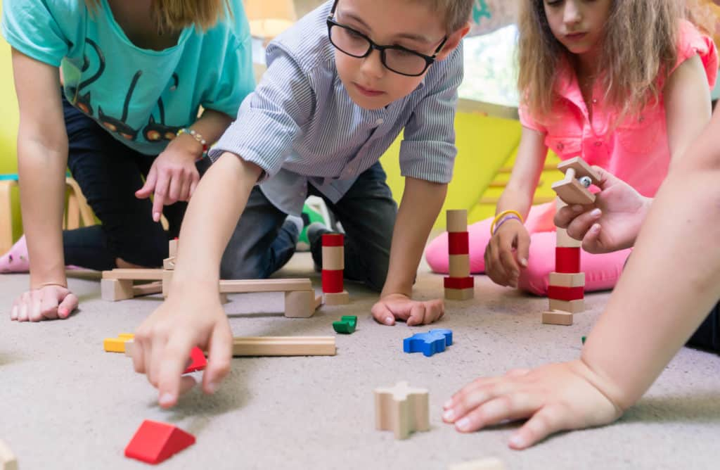 Developmental milestones for kindergarteners and how daycare management software can help teachers and parents keep track of all their accomplishments