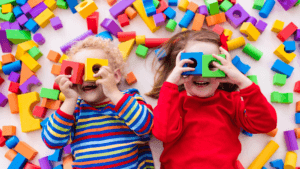 Two children playing with foam shapes